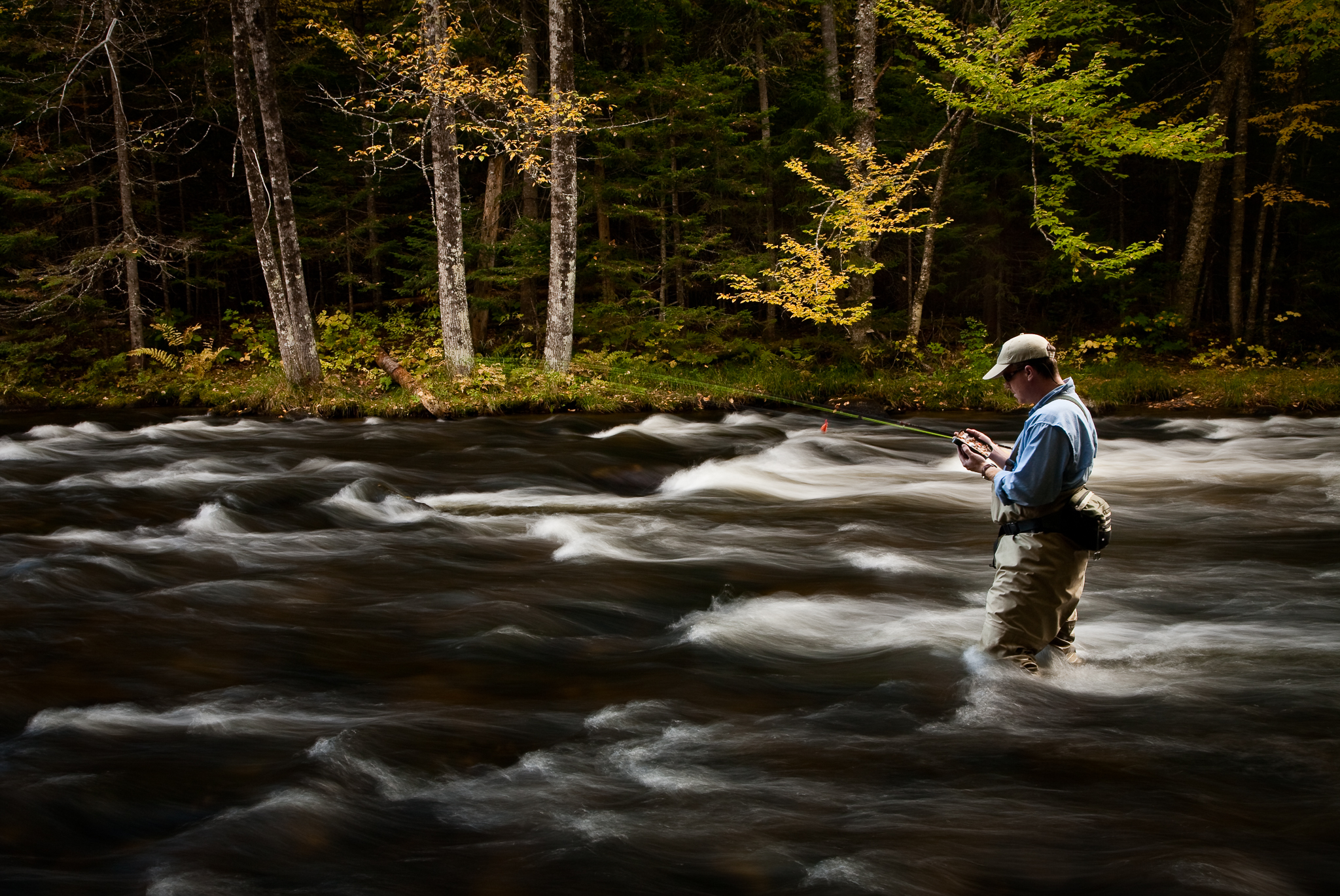 Image of a fly fisherman on the upper Connecticut River, NH
