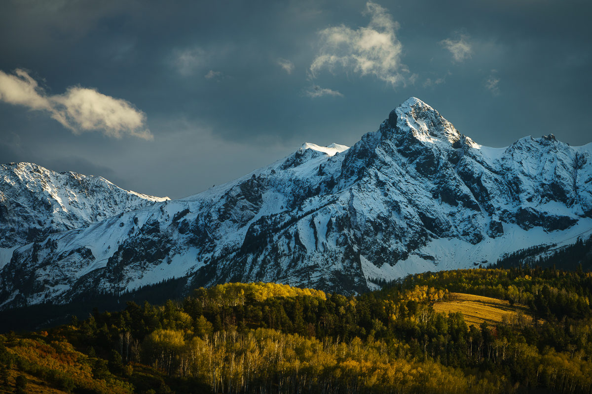 photograph of the sneffels range in autumn after a clearing storm