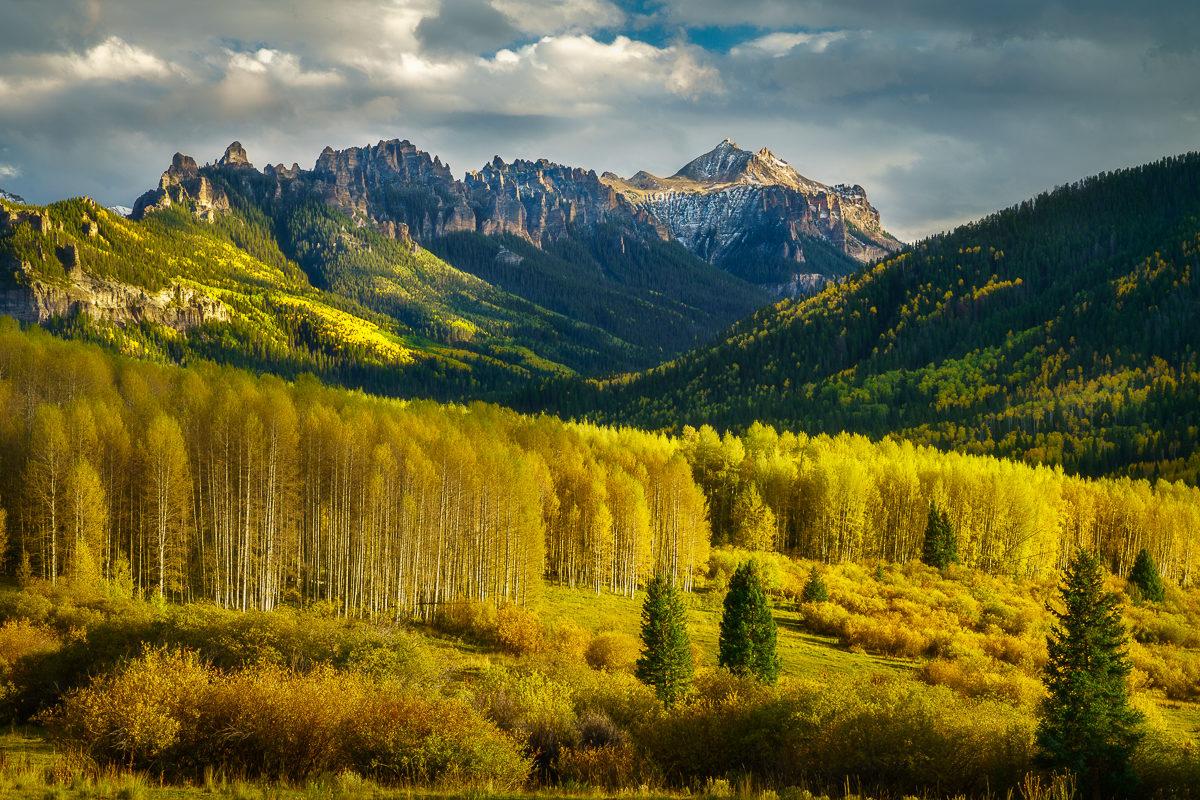 Landscape photograph of autumn aspens and the San Juan Mountains